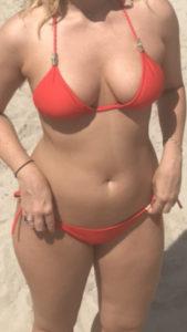 Sugar Baby Dubai in red bikini